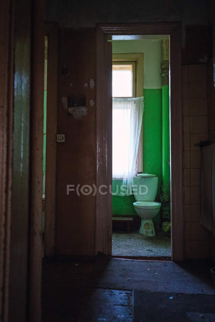 View of small room with toilet in shabby aged apartment — Stock Photo