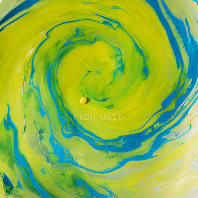 Blue and green inks blending in swirls — Stock Photo