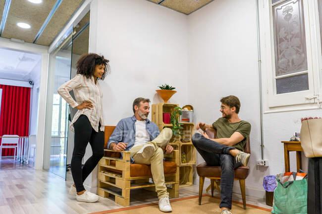 People sitting in creative meeting room — Stock Photo