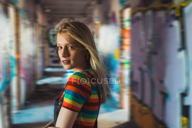Rebel girl among bright graffiti — Stock Photo