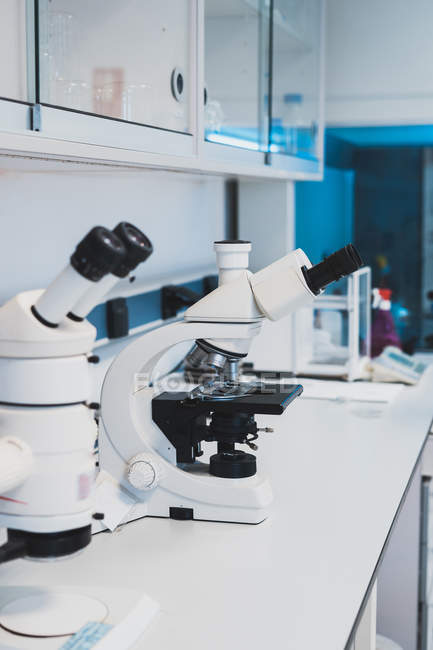 New white microscopes for medical research on desk in laboratory — Stock Photo