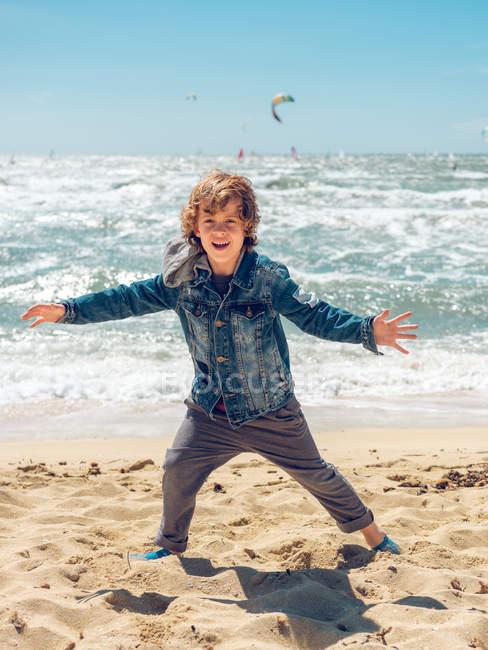 Boy having fun at seaside — стокове фото
