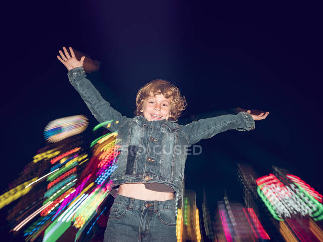 Boy jumping on funfair — Stock Photo