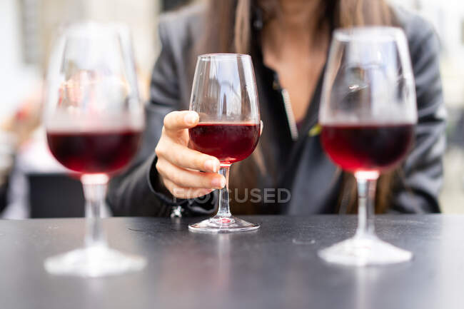Young women clanging glasses at table — Stock Photo