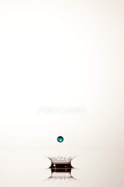Splash of transparent liquid of color on white background — Stock Photo