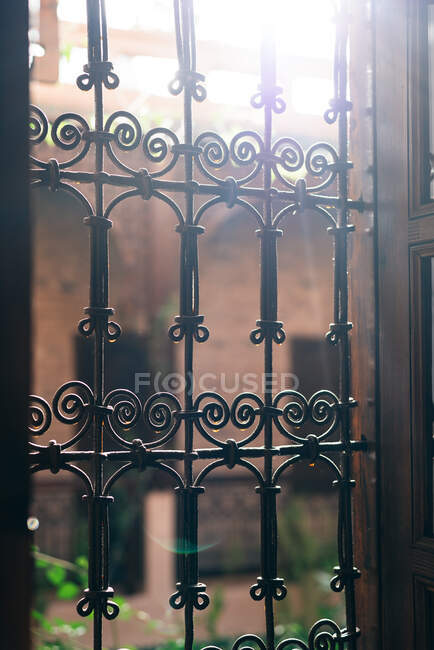 Vintage windows with security steel bars — Stock Photo