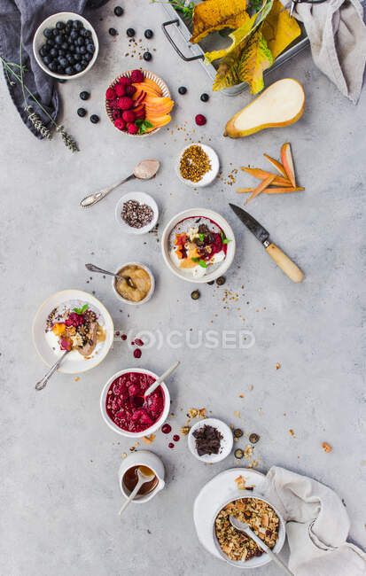 From above shot of delicious chia parfait and various fruits and grain lying on marble tabletop — Stock Photo