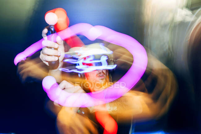 Man playing video game in dark — Stock Photo