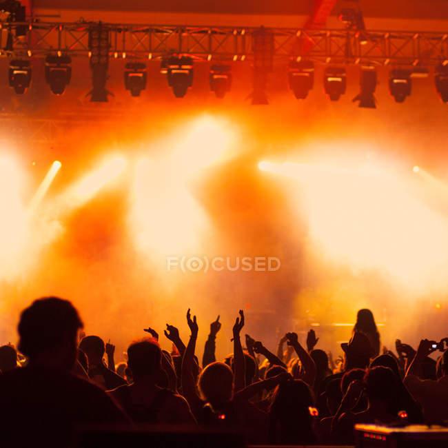 Unrecognizable people on illuminated dance floor — Foto stock