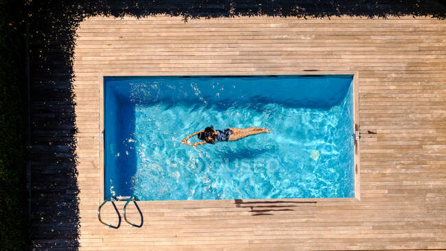 Anonymous woman swimming in pool — Stock Photo