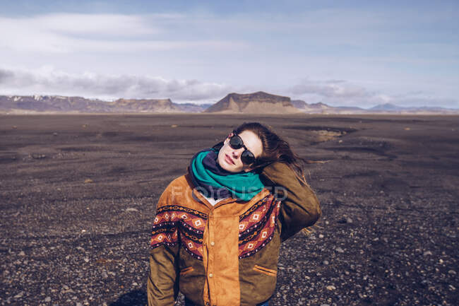 Smiling human with standing between dark grounds in Iceland — Stock Photo