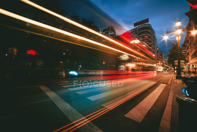 Abstract view of bright trail lights on urban route in evening on street — Stock Photo