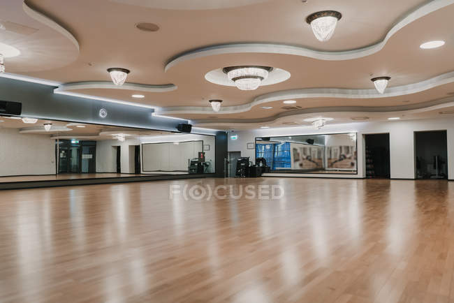 View of brightly illuminated spacious room of modern stylish gym — Stock Photo