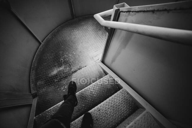 Legs of anonymous person standing on metal spiral stairway inside jail in Oviedo, Spain — Stock Photo