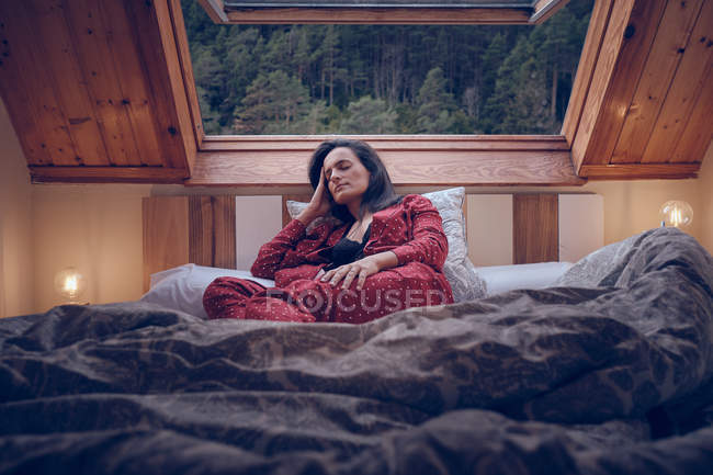 Sensual female lying on bed — Stock Photo