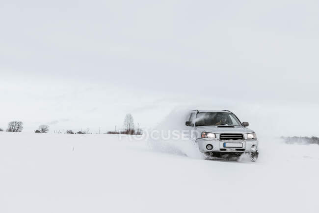 Car driving on snow field — Stock Photo