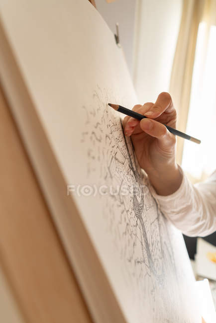 Person drawing city on canvas — Stock Photo