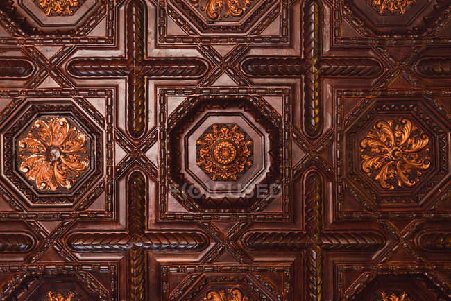Closeup beautiful brown ornamented panels with golden flowers — Stock Photo