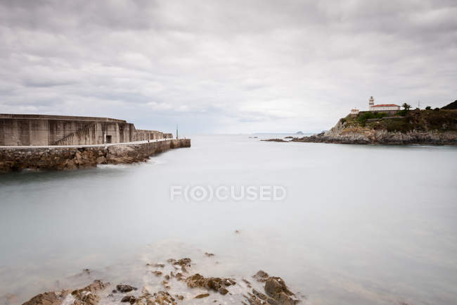 Bay with calm water and magnificent overcast sky — Stock Photo