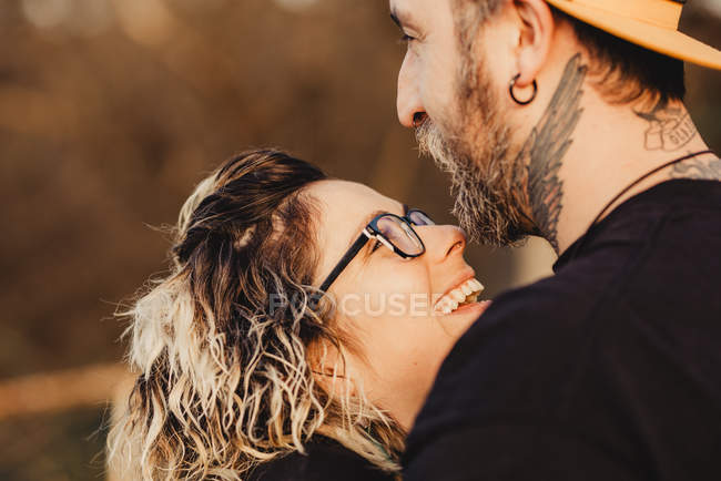 Happy couple looking at each other on sunny weather — Stock Photo