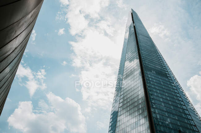 High-rise building on cloudy day — стокове фото