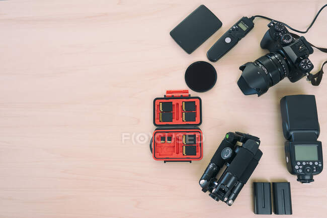 From above professional camera near equipments on wood background — Stock Photo