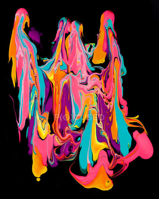 Thick paint of various bright colors flowing down and mixing together — Stock Photo