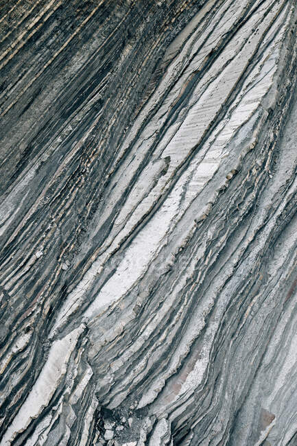 Closeup rough surface of gray rock cliff in Spanish countryside — Stock Photo