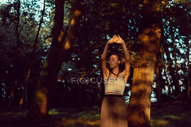 Young woman in majestic forest — Stock Photo