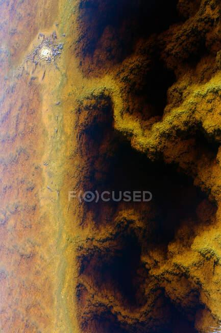 Multicolored mineral stratum on river — Stock Photo