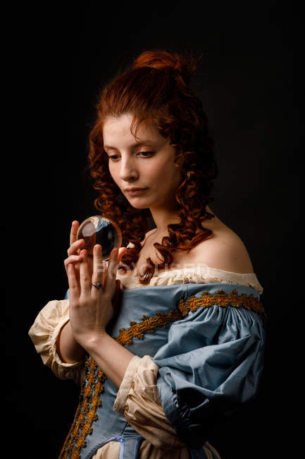 Baroque redhead woman holding magical glass ball. — Stock Photo
