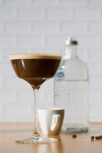 Espresso martini cocktail served in glass on table — Stock Photo