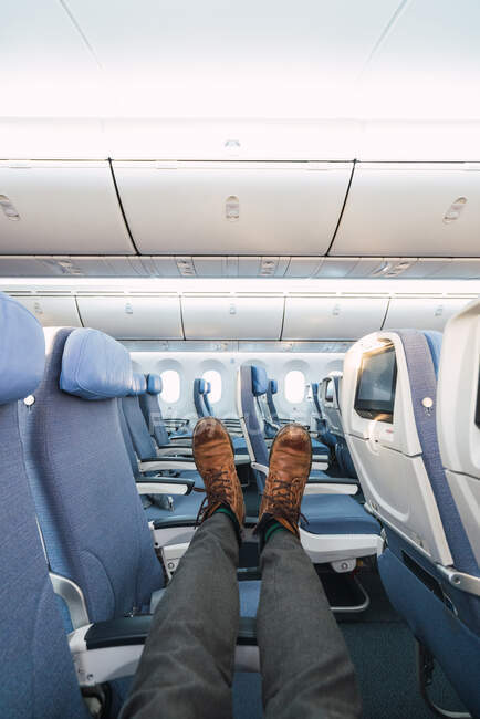 Crop legs on plane seats — Stock Photo