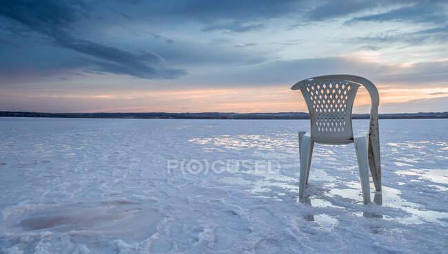 Chair on salt mine during sunset — Stock Photo
