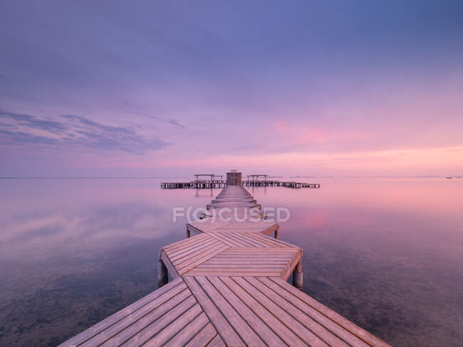 Wooden pier on cloudy evening — Stock Photo