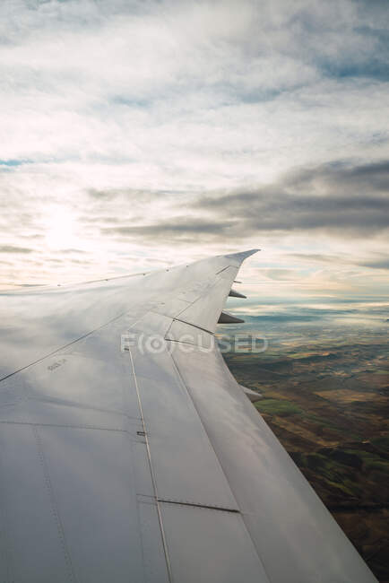 Bearded passenger using device in aircraft — Stock Photo