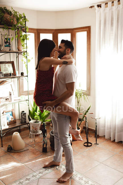 Passionate couple hugging in stylish room — Stock Photo