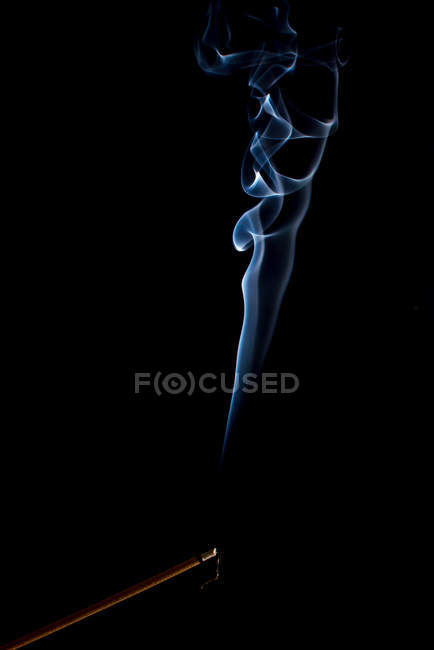 Swirls of bright blue fume on black background — Stock Photo