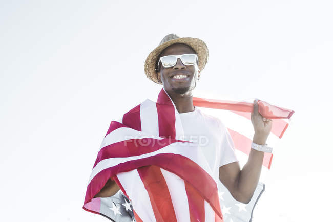 Cheerful black man with American flag — Stock Photo