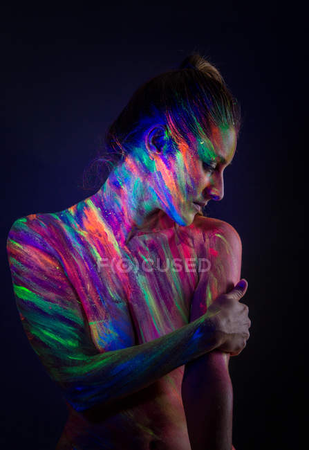 Topless model in neon lights — Stock Photo