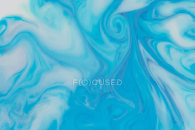 Flux abstrait de peintures liquides en mélange — Photo de stock