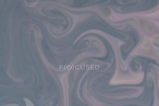 Abstract flow of liquid paints in mix — Stock Photo