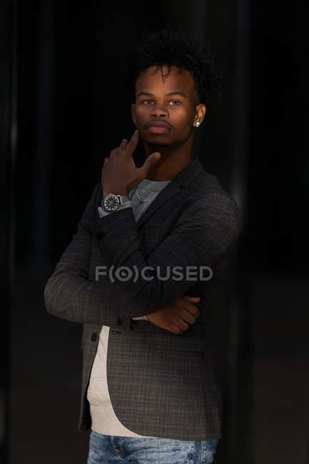 Black businessman posing on street — Stock Photo