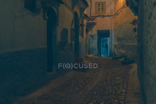 Amazing view of poor street between ancient houses in evening in Marrakesh, Morocco — Stock Photo