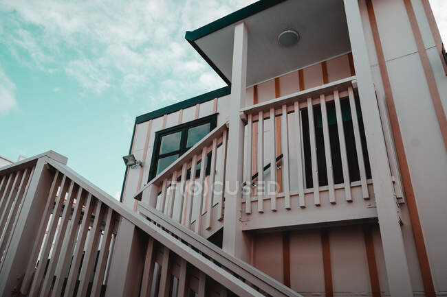 From below wooden stairs of cottage in west neighborhood — Stock Photo