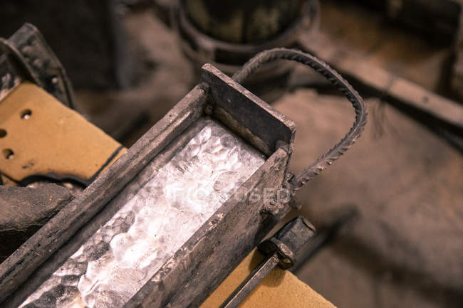 Heated metal in form on table — Stock Photo