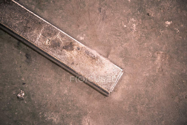 Steel product placed on concrete floor on little foundry — Stock Photo
