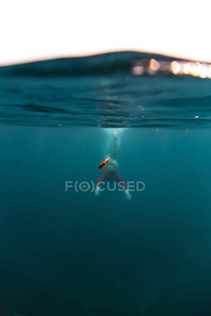 Silhouette of female diving in blue water of sea on Bali, Indonesia — Stock Photo