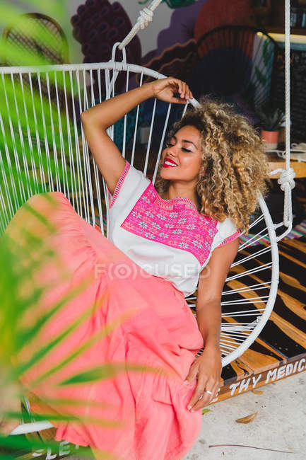 Relaxed black young woman with closed eyes and curly hair