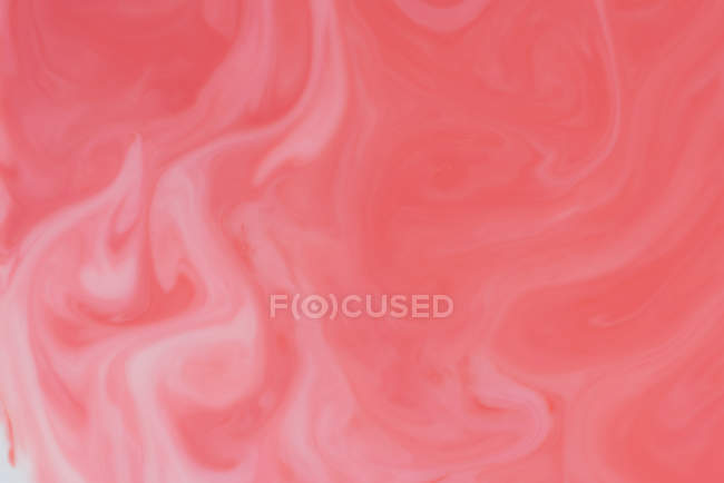 Abstract flow of colorful liquid paints in mix — Stock Photo